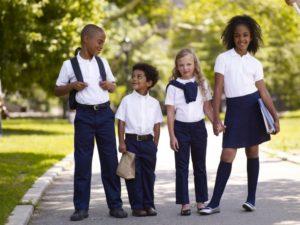 4 kids in school uniforms